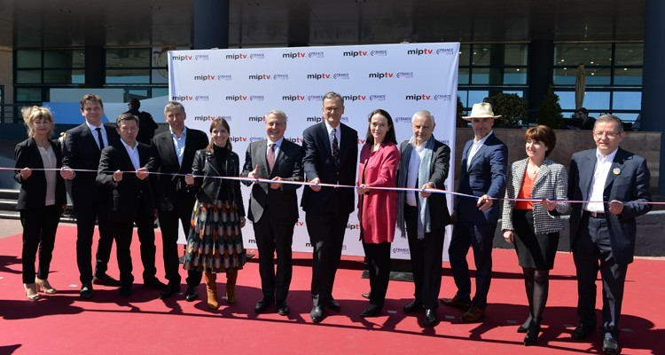 The 'ribbon cut' at the inauguration of MIPTV 2019 with Reed Midem's team led by Paul Zilk, CEO, Laurine Garaude, director of TV division, and Lucy Smith, deputy director of TV division